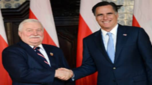 Republican presidential candidate and former Governor of Massachusetts Mitt Romney (R) shakes the hand of former Polish President and Nobel Peace Prize winner Lech Walesa, during a meeting at Artus Court, in Gdansk, on 30, 2012.
