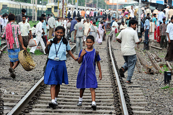 Millions of commuters were stranded across train stations in India as service came to a standstill after the country experienced one of the worst blackouts in history on Tuesday.Train stations in Kolkata (pictured) were swamped with people trying to get home after government offices and schools closed early in the city of five million. More than 300 trains were stuck on the tracks, halting rail services in up to 10 states, according to local media reports.