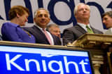 Thomas M. Joyce, chairman and chief executive officer of Knight Capital Group Inc., second from the right, waits to ring the opening bell at the New York Stock Exchange in New York, U.S., on Tuesday, May 25, 2010.