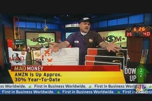 Cramer: Deciding Between FedEx & UPS