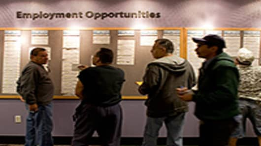 People check the jobs board at a Denver Workforce Center, part of the Denver Office of Economic Development, in Denver, Colorado, U.S.