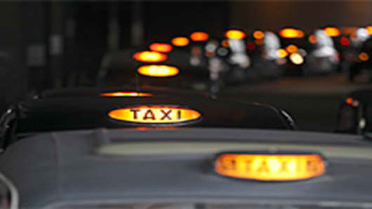 A queue of London taxis have their lights on showing they are available for a fare in London, U.K.