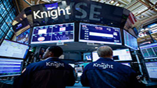 Traders work at a Knight Capital Group Inc. post on the floor of the New York Stock Exchange. Knight Capital Group Inc., struggling to stay afloat after a trading error spurred a $440 million loss.