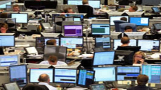 Employees work on the trading floor of DnB Nor ASA at the company's headquarters in Oslo, Norway.