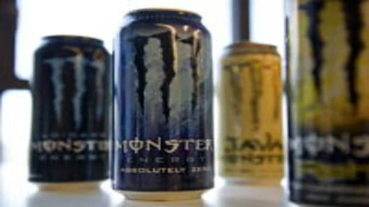 Cans of Monster Beverage Corp. energy drinks are arranged for a photograph in San Francisco, California, U.S., on Monday, April 30, 2012. Monster Beverage Corp. surged the most in almost eight years after the Wall Street Journal reported Coca-Cola Co. is in talks to buy the maker of energy drinks.