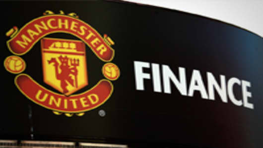 The Manchester United soccer club badge is displayed outside the Old Trafford stadium in Manchester, U.K., on Thursday, Aug. 25, 2011.