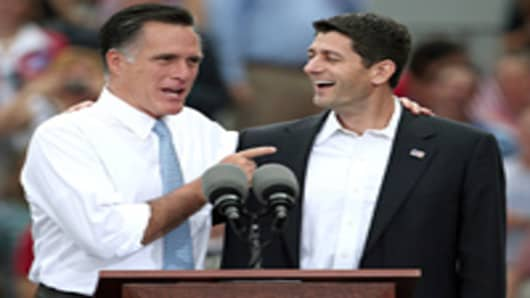 Republican presidential candidate, former Massachusetts Gov. Mitt Romney (L) jokes with U.S. Rep. Paul Ryan (R-WI) (R) after announcing him as the 'next PRESIDENT of the United States' during an event announcing him as his vice presidential running mate.