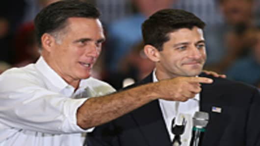 Republican presidential candidate and former Massachusetts Gov. Mitt Romney (L) and his vice presidential running mate Rep. Paul Ryan (R-WI) take the stage during a campaign event at the Crenshaw Gymnasium on the campus of Randolph-Macon College August 11, 2012 in Ashland, Virginia.