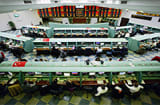 Traders work on the floor of the Istanbul Stock Exchange in Istanbul, Turkey.
