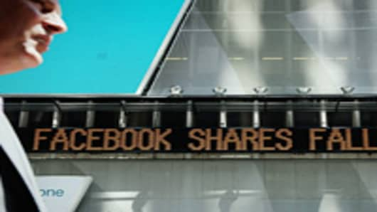 A news ticker announces the falling share price of Facebook in Times Square on August 16, 2012 in New York City. Shares of Facebook fell today on the NASDAQ stock exchange on the first d
