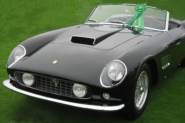"""A red '61 Ferrari 250 GT California was immortalized, sometimes in midair, as Cameron's dad's prized possession in the 1986 film """"Ferris Bueller's Day Off."""" Brauer says it's not only considered by many the most beautiful car ever created, but it's one of the most valuable collector cars today."""