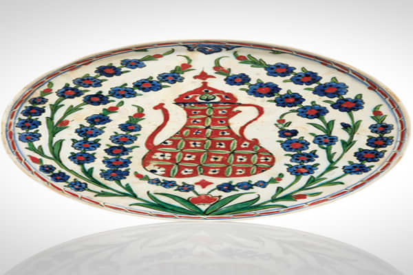 Circa 1590 12 in. diameter£32,450 ($50,923)This classic dish of the early Iznik school is from the Ottoman Empire and features common colors (blue, green and red) and design elements (flowers, vines).In the center of the dish is a ewer — a vase-shaped pitcher, often with a flaring spout.