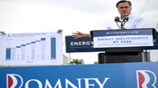 US Republican presidential candidate Mitt Romney shows a chart as he speaks during campaign event at Watson Truck and Supply in Hobbs, New Mexico, on August 23, 2012.