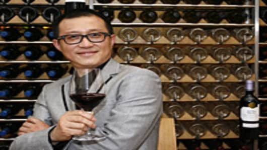 Dongjun Shen, group managing director of Chinese jewelry group Tesiro, poses on March 1, 2011, in a winebar in Bordeaux, in the world-renowned Bordeaux' wines region, southwestern France, after his group bought the 'cru bourgeois' Chateau Laulan Ducos in the Medoc area.