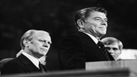 American president Gerald Ford (left) listens as future American president Ronald Reagan delivers a speech during the closing session of the Republican National Convention, Kansas City, Missouri.