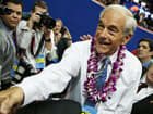 U.S. Rep. Ron Paul (R-TX) (R) greets a supporter as he walks the arena floor during the second day of the Republican National Convention at the Tampa Bay Times Forum on August 28, 2012 in Tampa, Florida.