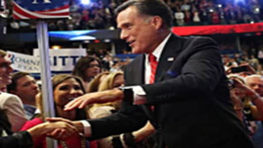Republican presidential candidate, former Massachusetts Gov. Mitt Romney (C) greets supporters as he enters during the final day of the Republican National Convention.