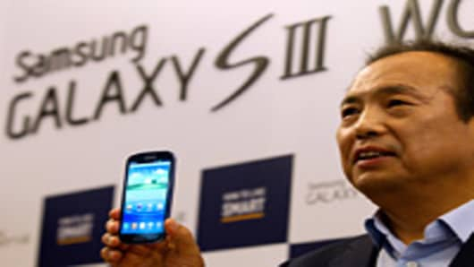 J.K. Shin, president of mobile communications for Samsung Electronics Co., presents the company's Galaxy S III smartphone at a launch event in Seoul, South Korea.