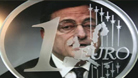 The guardian of the euro - Mario Draghi, president of the European Central Bank, ECB, behind a glass euro coin.