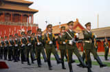 Chinese soldiers marching in front of the Forbidden City in Beijing, China.