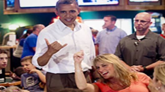 US President Barack Obama makes the Hawaiian symbol known as the 'shaka' during a visit to Gator's Dockside restaurant in Orlando, Florida.