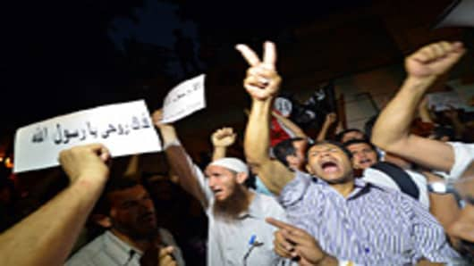An Egyptian protester hold a sign that reads in Arabic 'I sacrifice my soul for God's prophet' during a demonstration outside the US embassy in Cairo on September 11, 2012 against a film deemed offensive to Islam.