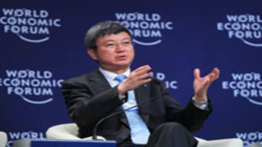 Zhu Min, Deputy Managing Director of the International Monetary Fund (IMF), attends a session during the 2012 Tianjin Summer Davos.
