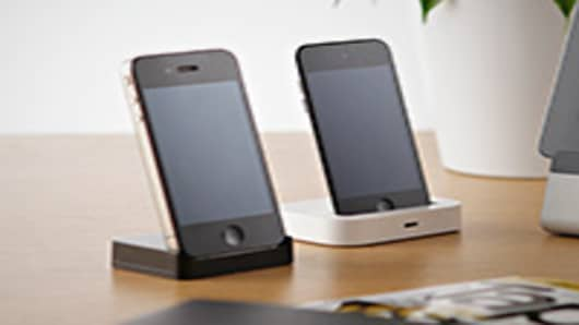 Apple iPhones on dock.