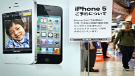 A notice (C) providing information on ordering the iPhone 5 is displayed at a Tokyo electrics shop on September 13, 2012.