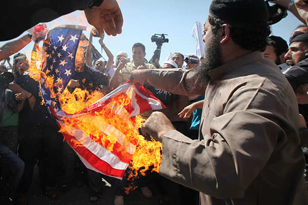 Salafists burn an American flag during a demonstration near the U.S. Embassy in Amman on Sept. 14.