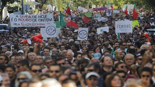 Demonstrators march during a protest against economic austerity measures in Portugal