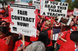 Striking Chicago teachers and their supporters attend a rally at Union Park September 15, 2012 in Chicago, Illinois. An estimated 25,000 people gathered in the park in a show of solidarity as negotiations on a labor contract continue.