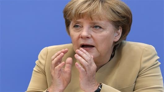 German Chancellor Angela Merkel gestures during a press conference in Berlin, Germany, Monday, Sept. 17, 2012. (AP Photo/Michael Sohn)
