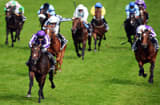 Horse &#039;Camelot&#039; (L) ridden by jockey Joseph O&#039;Brien heads the field to win the Derby race on Derby Day, the second day of the Epsom Derby horse racing festival, at Epsom in Surrey, southern England, on June 2, 2012 the first official day of Britain&#039;s Queen Elizabeth II&#039;s Diamond Jubilee celebrations.