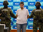 Mexican marines present to the press the alleged member of Zetas drug cartel Eric Jovan Lozano Diaz (C), aka 'Cucho', and some money seized during his arrestation in Mexico city, on June 15, 2012.