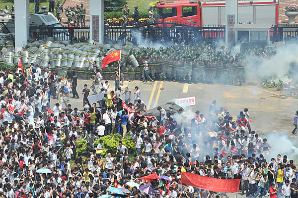 Chinese authorities had to use tear gas to disperse thousands of protesters during an anti-Japanese demonstration in the southern city of Shenzhen on Sunday. Protesters took to the streets in several Chinese cities including Shenzhen and Guangzhou, where crowds turned violent, clashing with the police. Water cannons were also used to stop protesters from trying to break into government buildings, and at least a dozen people were arrested, according to the South China Morning Post.