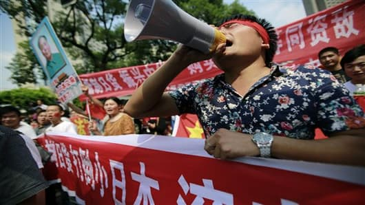 Protesters shout anti-Japan slogans near the Japanese Consulate General in Shanghai, China.
