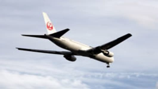 A Japan Airlines aircraft in flight.
