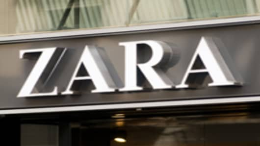 A logo sits above the entrance to a Zara fashion store, operated by Inditex SA, in Barcelona, Spain.