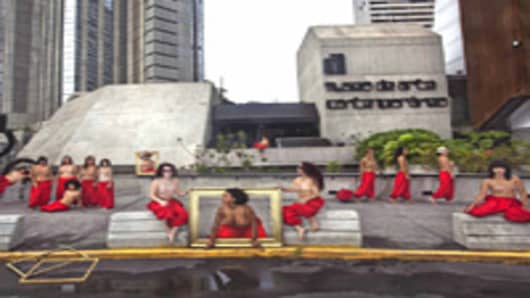 Topless women outside Caracas Museum of Contemporary Art protest for return of Henri Matisse painting.