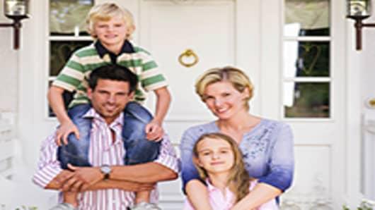 _family-standing-infornt-house-200.jpg