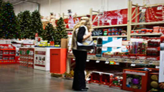 A customer shops in the holiday decorations area at a Home Depot store.