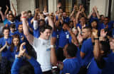 At the Apple store in Covent Garden, London, Ryan Williams 22, of Kent, was first in line and is cheered by Apple employees as he is the first to purchase the iPhone 5. Mr Williams hopes to raise money for Cancer Research UK by auctioning the phone, and has been waiting in line for nearly a week.