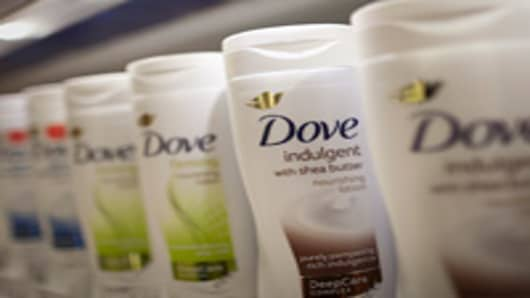 Bottles of Dove body lotion, manufactured by Unilever NV, are seen in a supermarket in Slough, U.K., on Monday, Sept. 3, 2012. U.K. retail same-store sales barely rose in July, according to the British Retail Consortium, as consumer confidence was undermined by the double-dip recession and the euro-area debt crisis