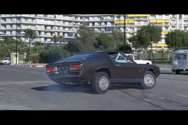 "The Marseille Contract, which was eventually renamed The Destructors, is a film about a U.S. intelligence agent who, when he was unable to bring a drug baron to justice through conventional means, hires a contract killer to finish the job. In the film, John Deray, played by Michael Caine, drives an Alfa Romeo Montreal alongside a yellow Porsche 911, in a choreographed ""race""  The Montreal, which was discontinued in 1977, used a 2.6L V8 and could reach top speeds of 137 mph."