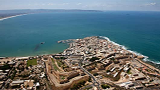 An aerial view looking south along the Mediterranean coast of the walled old city of Akko in northern Israel.