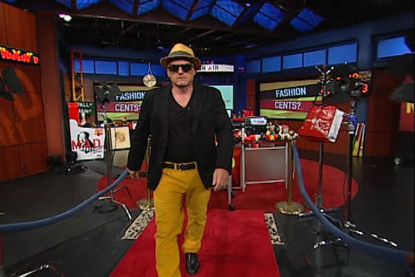 """Look at Cramer strut his stuff! The """"Mad Money"""" host is dressed as a model, walking the catwalk, as he discussed retail stocks that have been fashionable on Wall Street. Gap (GPS), Lululemon (LULU), Michael Kors (KORS), and Urban Outfitters (URBN) were among the retailers mentioned. Cramer isn't dressed in any particular brand here, though."""