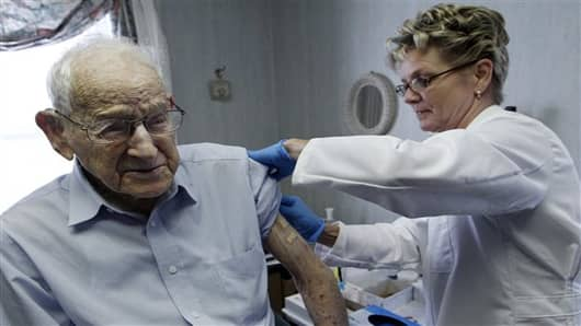 A man is is given his annual flu shot.
