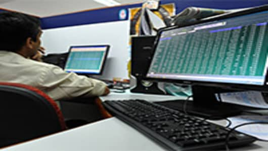 Indian stock dealers keep a watch on share prices at the Bangalore Stock Exchange.
