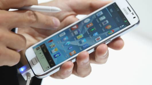 A visitor tries out the new Samsung Galaxy Note II smartphone at the Samsung stand at the IFA 2012 consumer electronics trade fair on August 30, 2012 in Berlin, Germany.